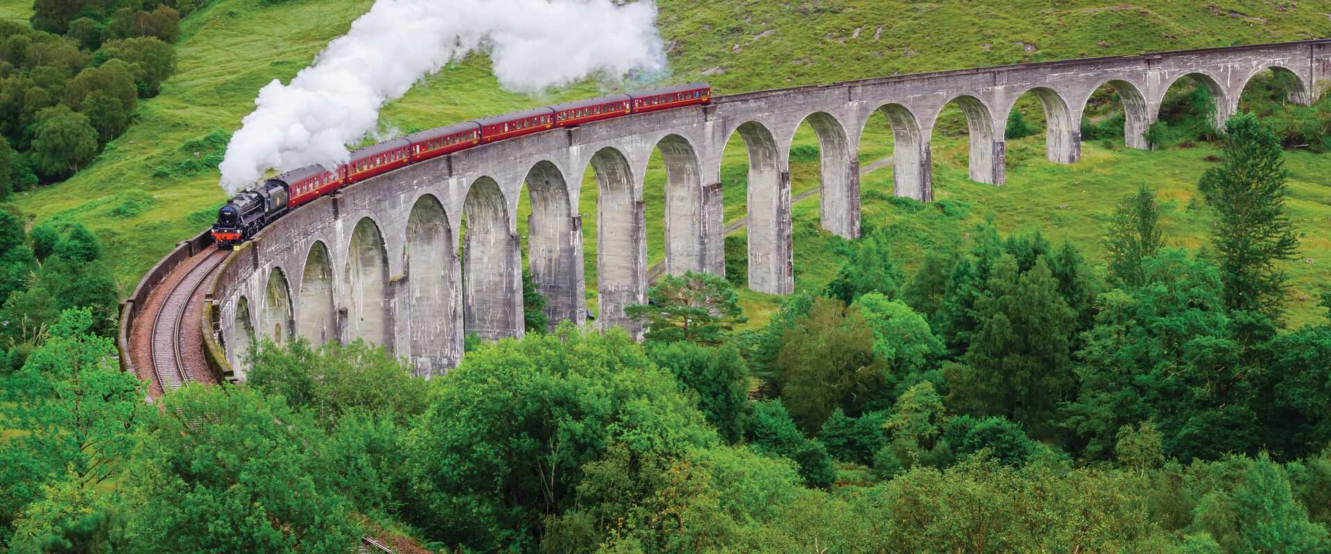 View of Jacobite Steam Train on Glenfinnan Viaduct in the Highlands, Scotland