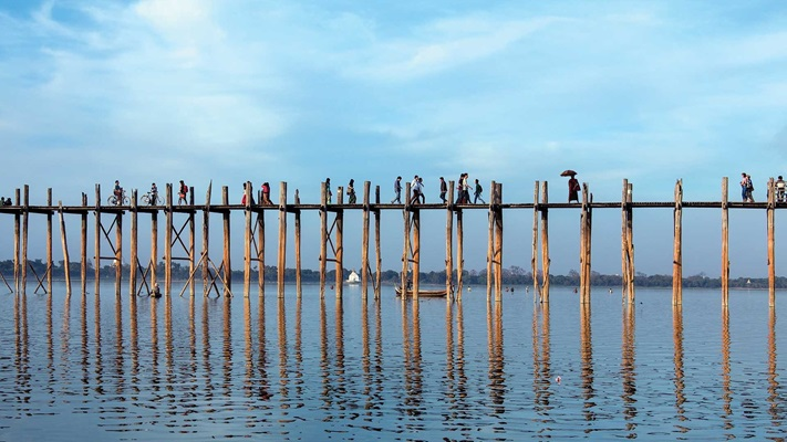 Long timber bridge across the water, Myanmar
