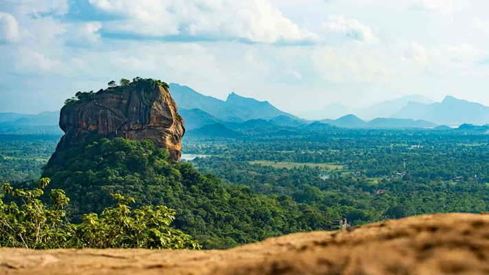 Large rock overlooking wide open valley, Sri Lanka