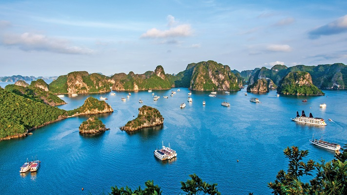 Aerial view of Ha Long Bay bathed in sunlight