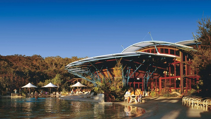 Exterior view of resort meeting the edge of the water, Australia