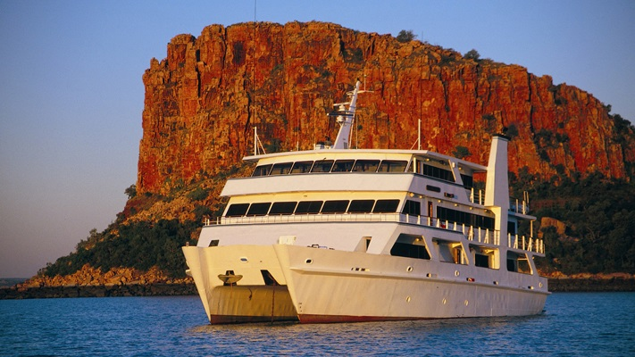 Ship moored at Raft Point with huge red cliffs, WA