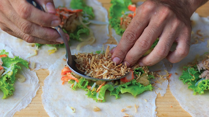 Observe the making of delicious traditional Vietnamese spring rolls