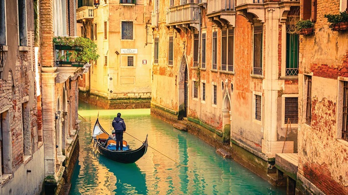 View of Gondola travelling along canal, Venice