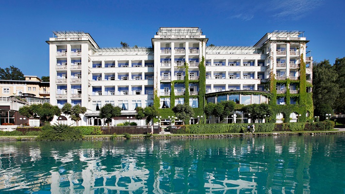 Multi storyed hotel lakeside overlooking turquoise lake on a sunny day