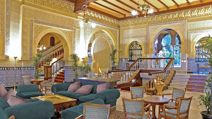 Hotel lobby with arched entrances, detailed fret work and sitting areas