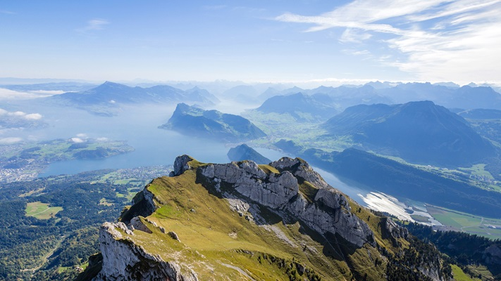 View of valley and lakes below from the top of Mt Pilatus, Switzerland
