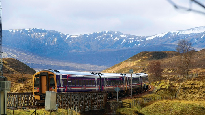 Train journeying through the Scottish Highlands