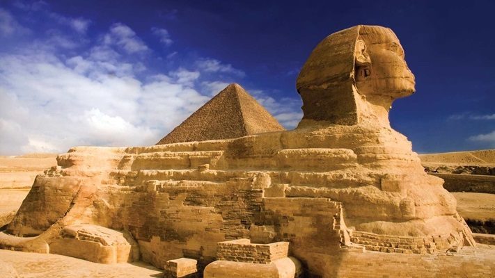 Layered pyramid with blue sky in background, Egypt