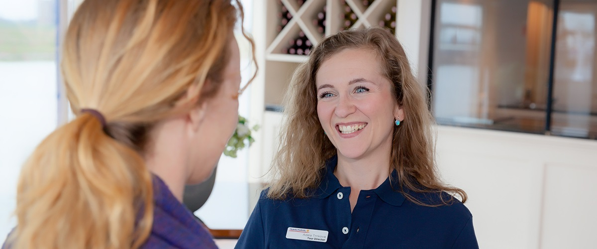 Travelmarvel Cruise Director talking with a passenger