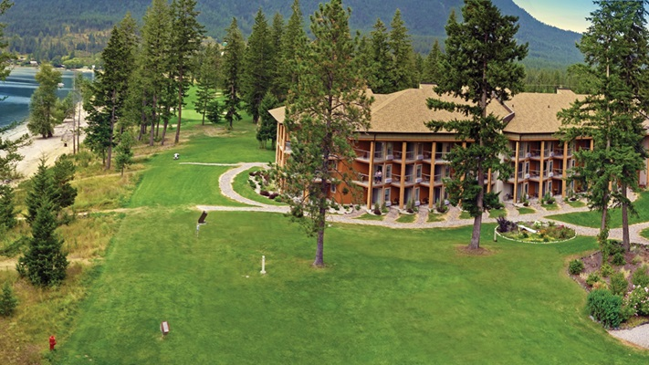 View of Quaaout Lodge from above surrounded by tall trees