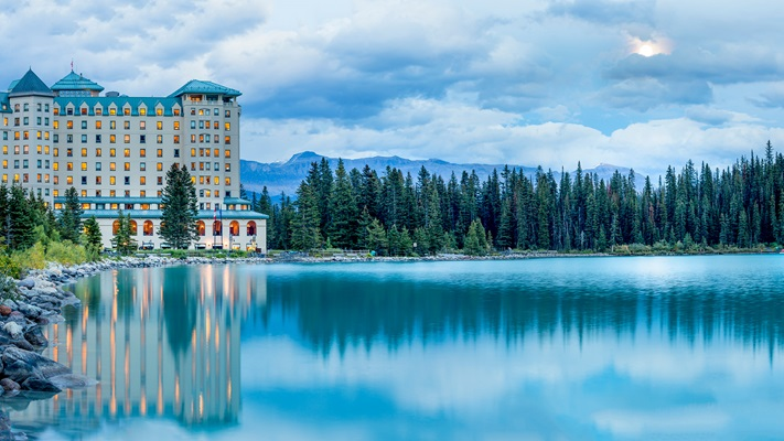 Gaze across Lake Louise at the accommodation of the luxurious Fairmont Chateau