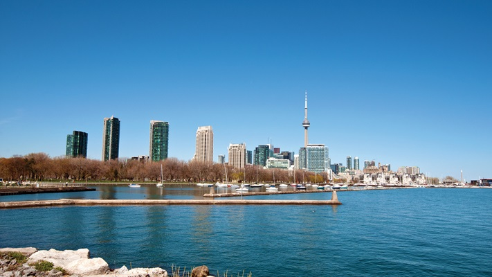 Lokking across lake to Toronto city skyline on a sunny day
