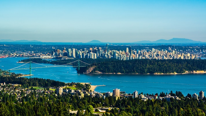 Panoramic view of Vancouver city looking across river to the city centre