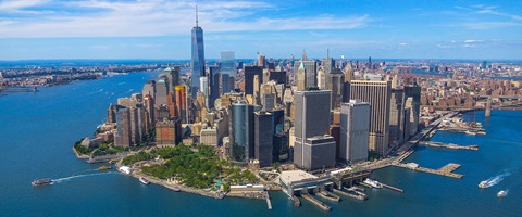 Aerial view of Manhattan Island New York city and surrounding bay region on a bright sunny day