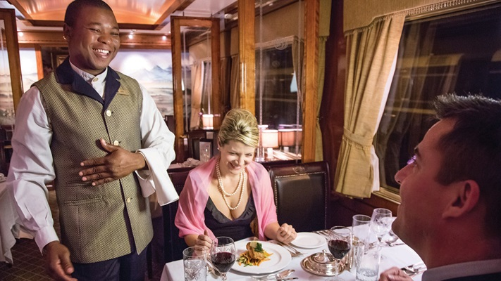 Passengers on the Blue Train enjoying friendly service