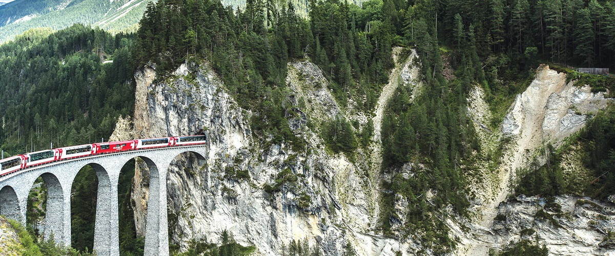 Glacier Express crossing the Landwasser Viaduct into mountain tunnel